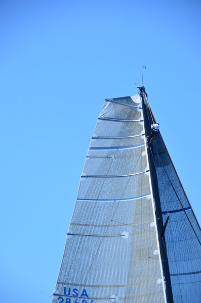 sailor climbig to top of mast